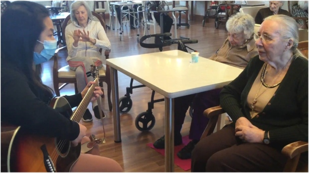 Music therapist Carmen Ng is seen here performing for residents at long-term care home 147 Elder Street. (CTV News Toronto/Corey Baird)