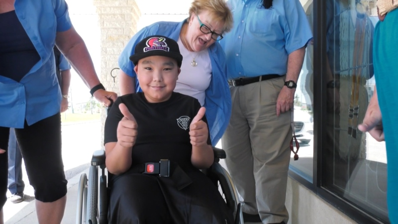 Romeo Nakoolak is all smiles after receiving a brand-new custom wheelchair from the Shriners Club. The wheelchair is a replacement for his old wheechair, which was stolen in February.