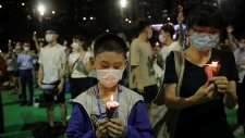 Participants holds candles during a vigil for the victims of the 1989 Tiananmen Square Massacre at Victoria Park in Causeway Bay, Hong Kong, Thursday, June 4, 2020, despite applications for it being officially denied. China is tightening controls over dissidents while pro-democracy activists in Hong Kong and elsewhere try to mark the 31st anniversary of the crushing of the pro-democracy movement in Beijing's Tiananmen Square. (AP / Kin Cheung)