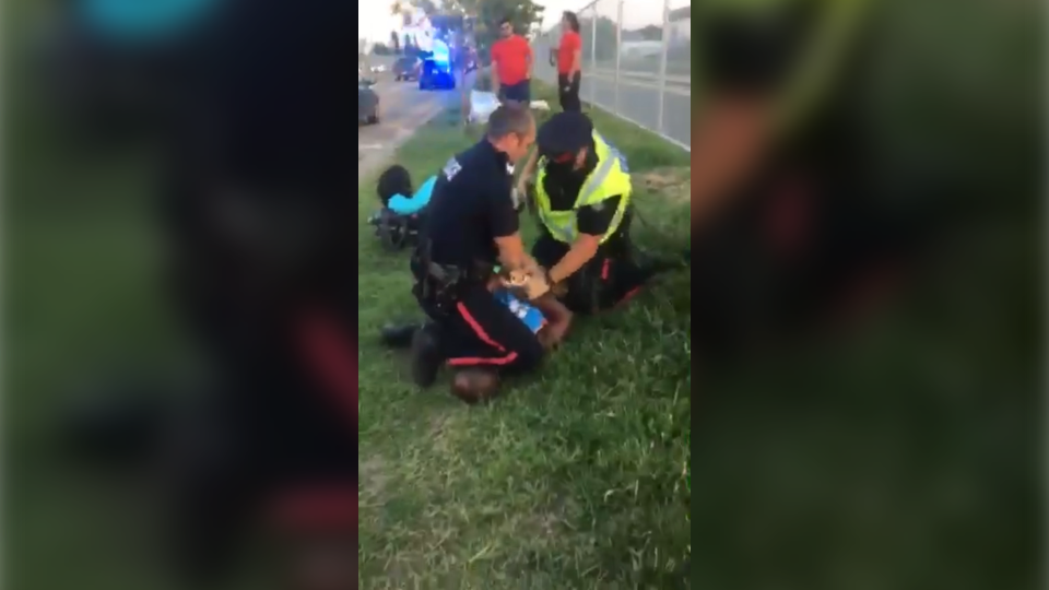 Video shows an Edmonton Police Service officer putting his shin on Jean-Claude Rukundo's neck during an arrest on July 27, 2018.