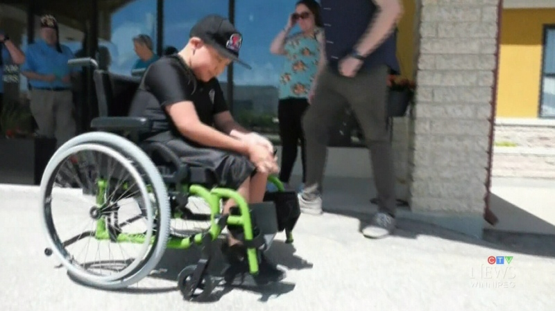 Winnipeg boy receives new custom wheelchair