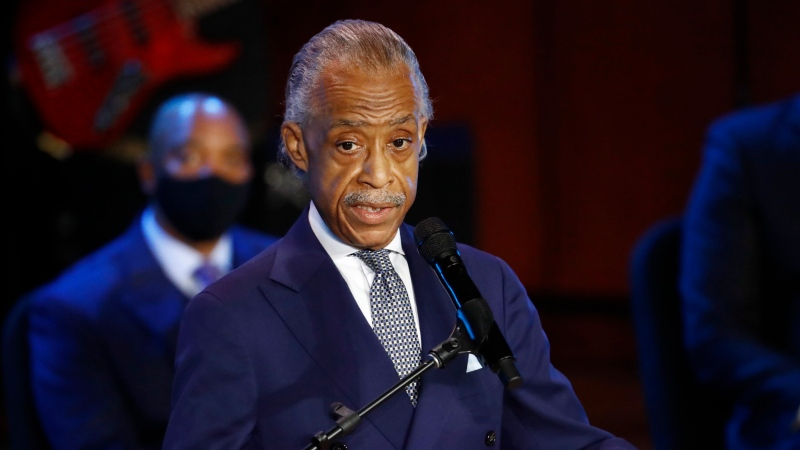 The Rev. Al Sharpton speaks at a memorial service for, George Floyd at North Central University Thursday, June 4, 2020, in Minneapolis. (AP Photo/Julio Cortez)