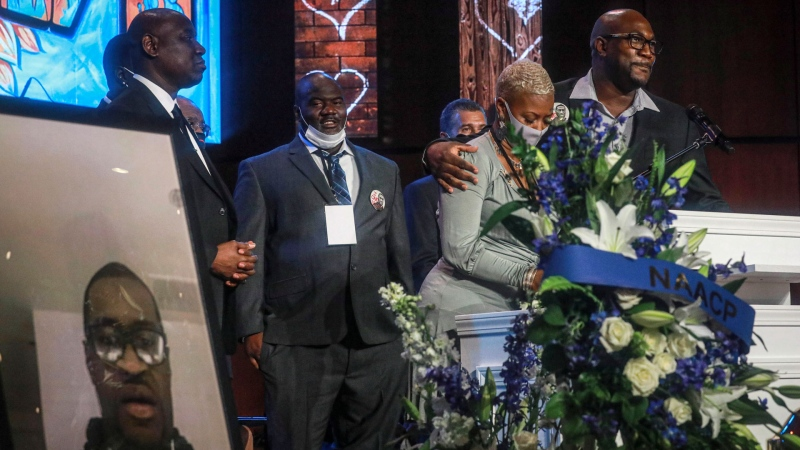 George Floyd's brother Philonise Floyd, far right, and cousin Shareeduh Tate, second from right, share their memories of Floyd at a memorial service at North Central University, on Thursday, June 4, 2020, in Minneapolis. (AP / Bebeto Matthews)