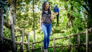 Wildlife conservationist Corina Newsome -- with Tony, a Hyacinth Macaw -- is a part of Black Birders Week. (Corina Newsome via CNN)