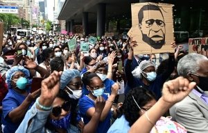 Nurses and healthcare workers attend a 'Black Lives Matter' rally in front of Bellevue Hospital on June 4, 2020, in New York City. (JOHANNES EISELE/AFP)