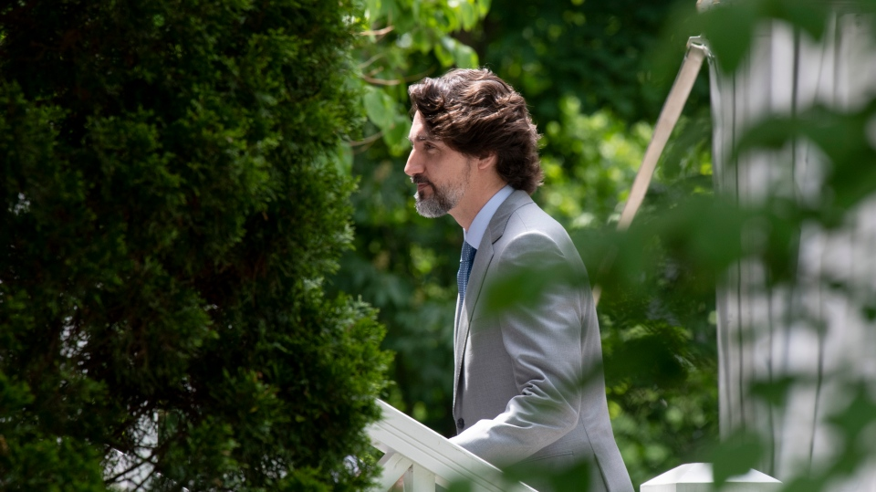 Prime Minister Justin Trudeau walks up the front stairs of Ridea Cottage following a news conference in Ottawa, Thursday June 4, 2020. (THE CANADIAN PRESS/Adrian Wyld)