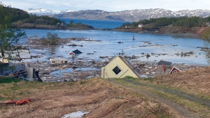 Debris fills the bay near Alta, Norway, Wednesday June 3, 2020, after a powerful landslide that took some eight houses into the sea off northern Norway. (Anders Bjordal/NTB Scanpix via AP)