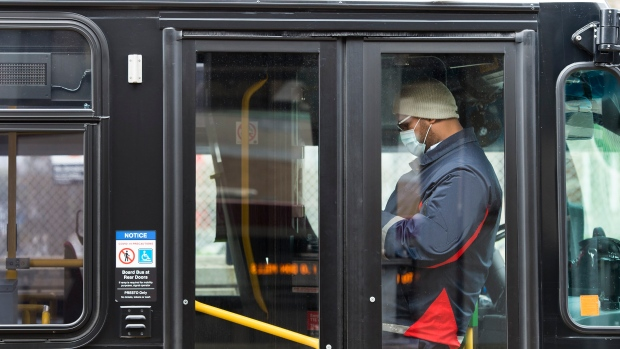 A TTC worker wears a mask in a bus while on shift in Toronto on Thursday, April 23, 2020. (Nathan Denette/The Canadian Press)