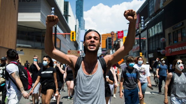 Thousands of people protest at an anti-racism demonstration reflecting anger at the police killings of black people, in Toronto on Friday, June 5, 2020. THE CANADIAN PRESS/Nathan Denette