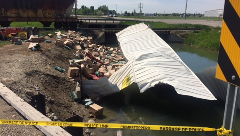A damaged trailer taped off in an irrigation canal near the intersection of Highway 3 and RR 21-1, east of Lethbridge, on June 5, 2020