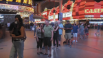 Many people were seen waiting to enter the newly reopened casinos in Las Vegas Thursday, shortly after midnight.