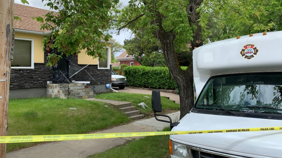Investigators on the scene of a fatal house fire in North Battleford on June 5, 2020. (Nicole Di Donato)