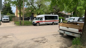 Investigators on the scene of a fatal house fire in North Battleford June 5, 2020. (Nicole Di Donato)