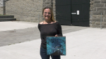 Artist Lisa Free stands with a canvas painting of the historic train tunnel in Brockville.  (Nathan Vandermeer/CTV News Ottawa)