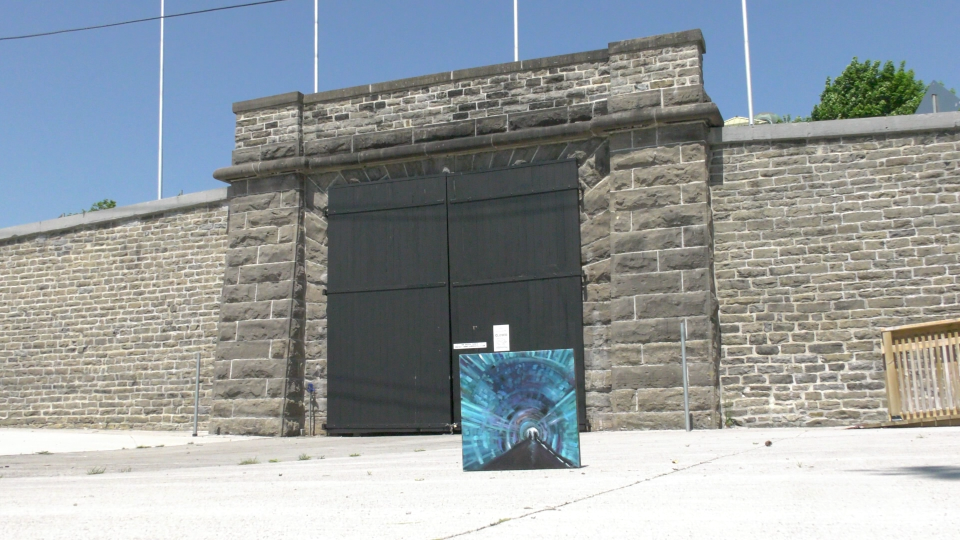 Lisa Free's painting in front of the historic train tunnel in Brockville. (Nathan Vandermeer/CTV News Ottawa)