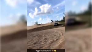 This image taken from video shows vehicles damaging a newly planted cornfield near Delaware, Ont. (@katelyn_fife / Twittter)