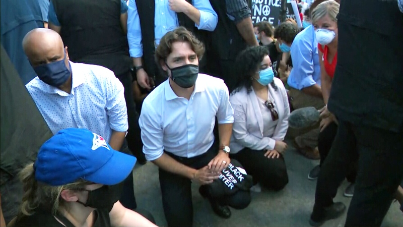 Prime Minister Justin Trudeau takes a knee at an anti-racism demonstration in Ottawa, Friday, June 5, 2020.