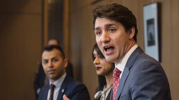 "Prime Minister Justin Trudeau, alongside Liberal MPs (from left) Marwan Tabbara, Bardish Chagger and Raj Saini meet with Region of Waterloo mayors and delivers brief opening remarks in Kitchener, Ont., on Wednesday, April 17, 2019. The Prime Minister's Office says it learned this morning about multiple criminal charges laid against Liberal MP Marwan Tabbara and is ""looking into the matter."" THE CANADIAN PRESS/Christopher Katsarov"