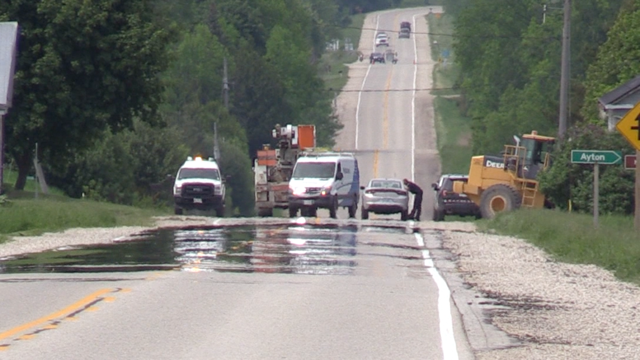 Police work at the scene after a payloader, believed to be stolen, was driven recklessly near Clifford, Ont. on Friday, June 5, 2020. (Scott Miller / CTV London)