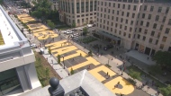 'Black Lives Matter' was painted in large, yellow letters on a busy street of Washington, D.C. ahead of a planned protest this weekend.