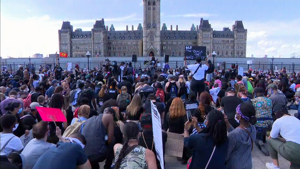 The crowd takes part in 8 minutes and 46 seconds of silence in tribute to George Floyd at the 'No Peace Until Justice' march on Parliament Hill in Ottawa on Friday, June 5, 2020.