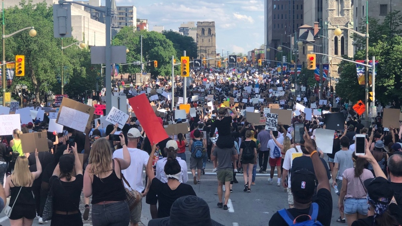 'No Peace Until Justice' marchers head down Elgin Street. This is just some of the crowd. There are many thousands of people here. (Michael Woods/CTV Ottawa)