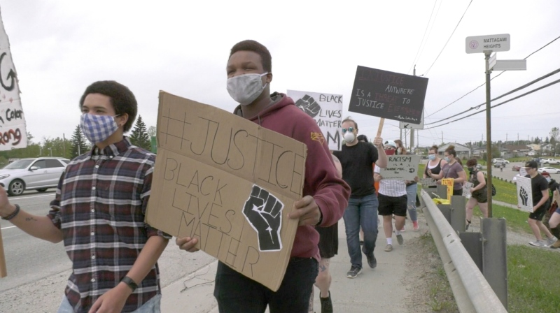 Dozens of people of various backgrounds marched again in Timmins on Friday to protest racism. (Lydia Chubak/CTV News)