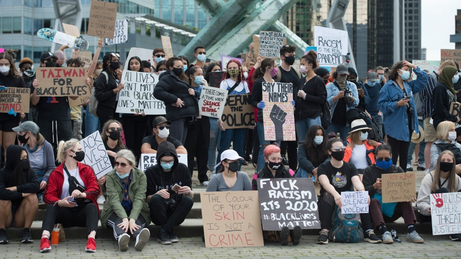 Thousands of people gather for a peaceful protest in Vancouver on June 5, 2020 in solidarity with the George Floyd protests across the United States. (THE CANADIAN PRESS/Jonathan Hayward)