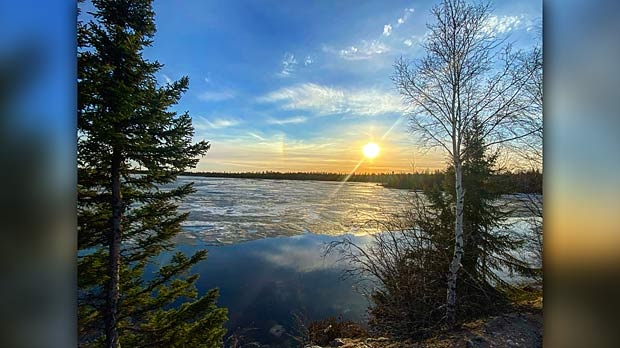Beautiful sunset in Lac Brochet. Photo by Amy Antsanen.