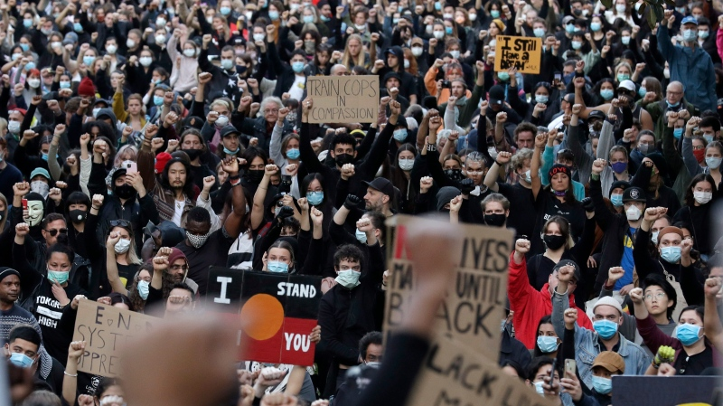 Thousands of protestors gather in Sydney, Saturday, June 6, 2020, to support the cause of U.S. protests over the death of George Floyd. (AP Photo/Rick Rycroft)