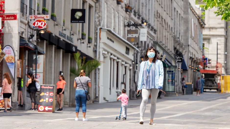 People walk past closed restaurants and bars in Old Montreal Thursday June 4, 2020 in Montreal. The government is reportedly allowing reopening the bars and restaurants next week.THE CANADIAN PRESS/Ryan Remiorz