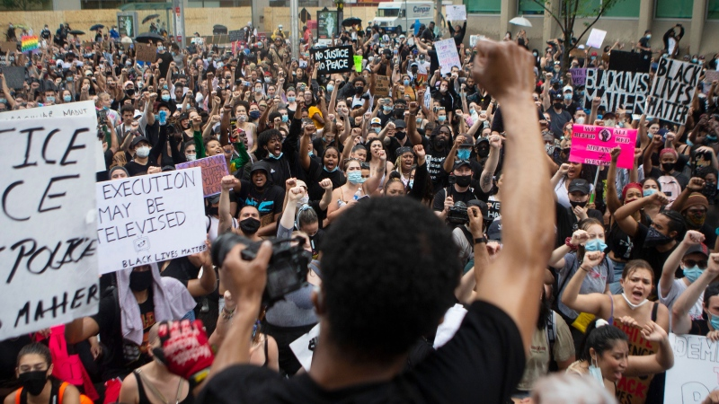 Protesters gather in Toronto to honour black lives lost at the hands of police, on Friday, June 5, 2020. THE CANADIAN PRESS/Chris Young