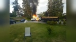 A pickup truck caught fire in Saanich Saturday morning, disrupting an otherwise peaceful neighbourhood. (Rodney Mack)