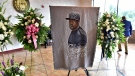 A picture of George Floyd and flowers are set up for a memorial service for Floyd, Saturday, June 6, 2020, in Raeford, N.C. Floyd died after being restrained by Minneapolis police officers on May 25. (Ed Clemente/The Fayetteville Observer via AP, Pool)
