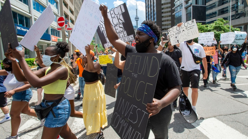 Anti-racism demostrators march through Toronto on Saturday, June 6, 2020. THE CANADIAN PRESS/Frank Gunn