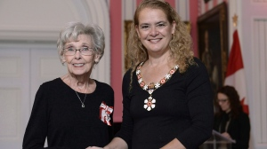 Andree Champagne, of Saint-Hyacinthe, Que., a television performer, Member of Parliament and Senator, is invested as a Member of the Order of Canada by Governor General Julie Payette during a ceremony at Rideau Hall in Ottawa on Tuesday, Nov. 20, 2018. THE CANADIAN PRESS/Justin Tang