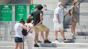 People wear face masks as they wait to enter the Museum of Fine Arts in Montreal, Saturday, June 6, 2020, as the COVID-19 pandemic continues in Canada and around the world. THE CANADIAN PRESS/Graham Hughes