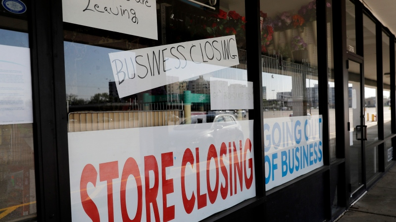 In this Wednesday, May 13, 2020 file photo, a sign announces a store closing in Niles, Ill. (AP Photo/Nam Y. Huh)