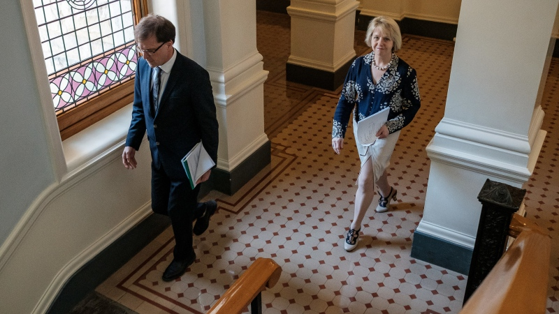 Health Minister Adrian Dix and provincial health officer Dr. Bonnie Henry walk to their COVID-19 briefing on June 1, 2020. (Province of B.C./Flickr)