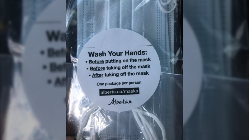Following the success of the first part of it's mask distribution plan, the province is again handing out masks at drive-thrus. (File)