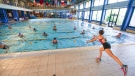 An instructor conducts a water gym lesson in the indoor swimming pool of the Forum sports center, on its reopening day after over two months of closure due to coronavirus restrictions, in Rome, Monday, May 25, 2020. (AP Photo / Andrew Medichini)