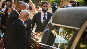 The casket of George Floyd is placed into a hearse at Fountain of Praise church in Houston, Monday, June 8, 2020. (Ricardo B. Brazziell/Austin American-Statesman via AP)