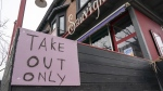 """A restaurant in Toronto displays a """"Take Out Only"""" sign on March 18, 2020. The Ontario government is putting a temporary ban on commercial evictions to help small business owners who are struggling to pay their rent amid the COVID-19 fallout. THE CANADIAN PRESS/Frank Gunn"""