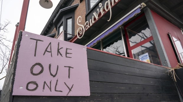 "A restaurant in Toronto displays a ""Take Out Only"" sign on March 18, 2020. The Ontario government is putting a temporary ban on commercial evictions to help small business owners who are struggling to pay their rent amid the COVID-19 fallout. THE CANADIAN PRESS/Frank Gunn"
