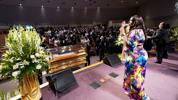 A singer performs by the casket of George Floydduring a funeral service for Floyd at The Fountain of Praise church Tuesday, June 9, 2020, in Houston. (AP Photo/David J. Phillip, Pool)