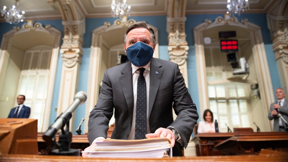 Quebec Premier Francois Legault arrives at his desk for question period, Tuesday, June 9, 2020 at the legislature in Quebec City. THE CANADIAN PRESS/Jacques Boissinot