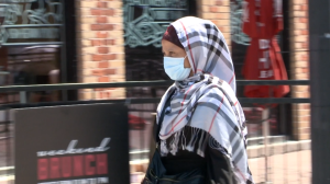 A woman wears a mask in Ottawa's ByWard Market.