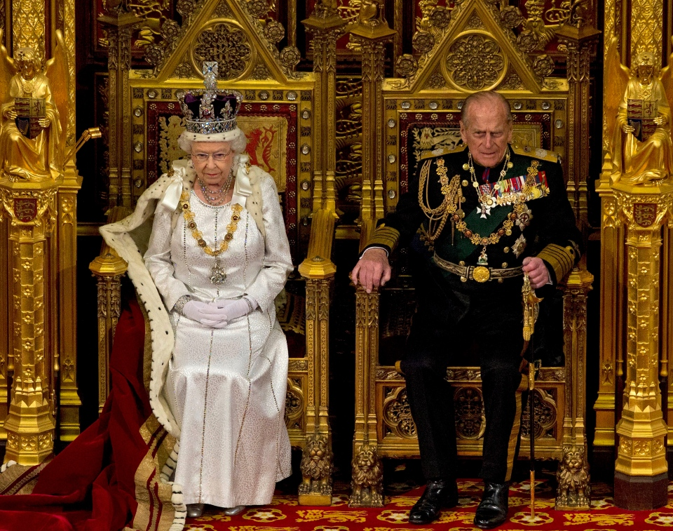 Queen Elizabeth II sits next to Prince Philip