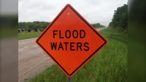 A sign warning motorists of flood waters is pictured on a road near near Vita, Manitoba in June 2020 (CTV News Photo Scott Andersson)