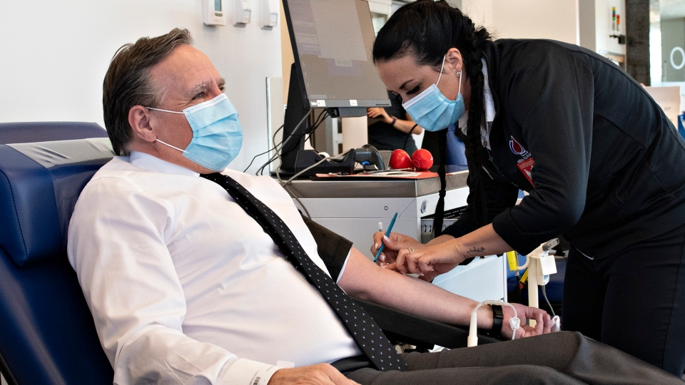 Quebec Premier Francois Legault prepares to donate blood at Hema-Quebec to promote it during the COVID-19 pandemic, Tuesday, June 9, 2020 in Quebec City. THE CANADIAN PRESS/Jacques Boissinot